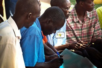 A community group meets in Uganda.
