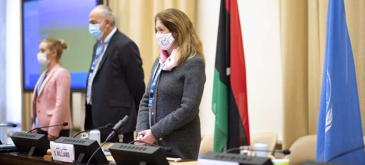 Acting Special Representative of the Secretary-General Stephanie Williams (right)and the delegations of the two parties listen to Libyan national anthem at the beginning of the Meeting of the Libyan Political Dialogue Forum's Advisory Committee, in Geneva on 13 January 2020.