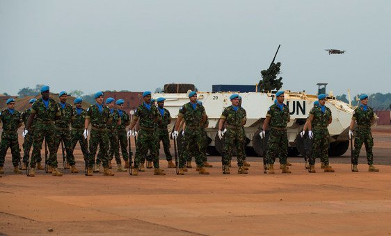 Portuguese UN peacekeepers stand in honour guard formation at the MINUSCA base in Bangui in the Central African Republic.