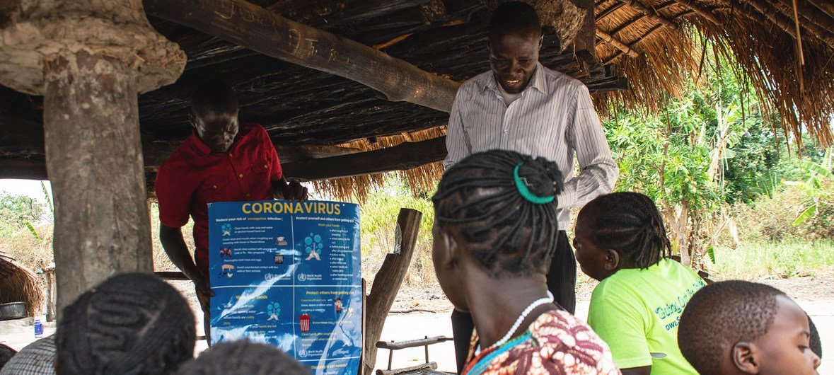 Villagers in South Sudan learn about the dangers of coronavirus from a UNICEF partner organization.