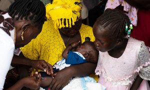 A 19-year old mother takes her three-month-old son to the Nyakuron primary health care centre in South Sudan's capital Juba for a polio and penta vaccine. When he is old enough, she will also inoculate him against measles.