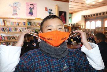 A grade six student in Paro, Bhutan, promotes the wearing of face masks.