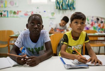 Two refugee boys in a classroom at a reception centre in Kos, Greece.
