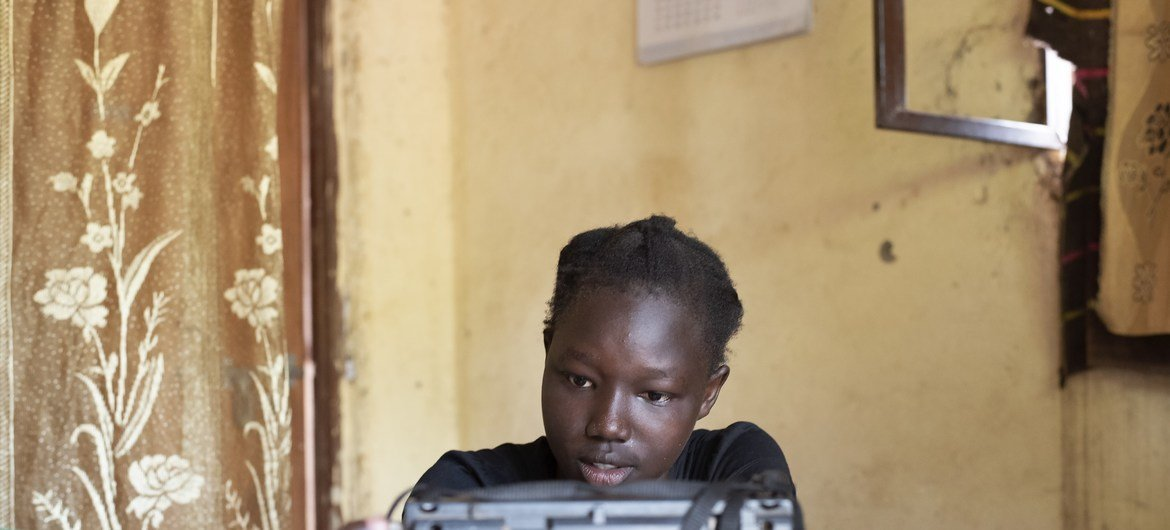 A 14-year-old girl tunes into English and science lessons in the South Sudanese capital, Juba.