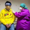 A young boy has a health check with a medical doctor amid cases of COVID-19 in Muntinlupa City, Philippines.