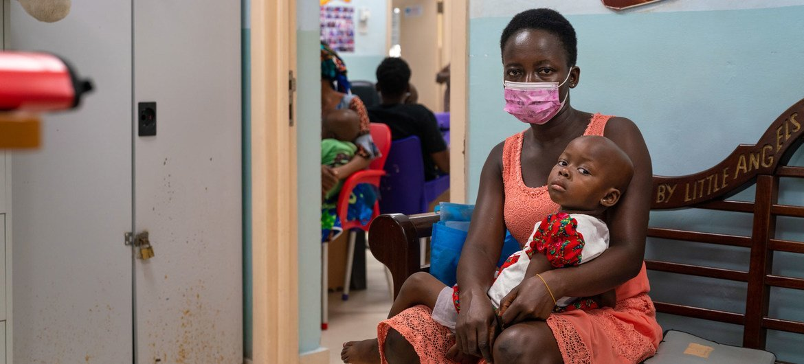 A two-year-old girl and her mother wait to see a doctor at the paediatric oncology unit at a hospital in Accra, Ghana.