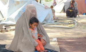A mother and her child in the Haji camp for internally displaced people in Kandahar, Afghanistan.