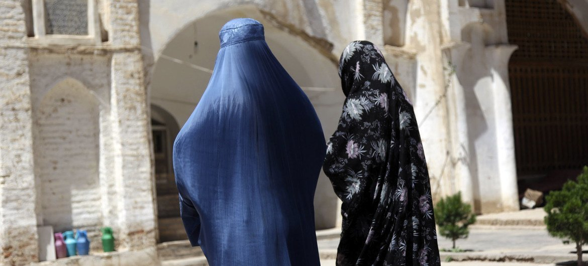 Two Afghan women  walk near an ancient mosque in western Herat province.