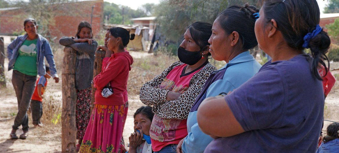 An indigenous community in Paraguay wait to receive their COVID-19 vaccination.