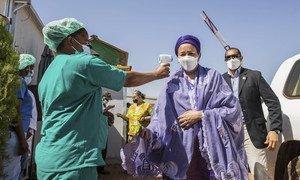 UN Deputy Secretary-General Amina Mohammed has her temperature taken to screen for COVID-19 symptoms on the UN compound in Bamako, Mali