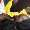 A young child is vaccinated against polio in Juba, South Sudan in March 2020.