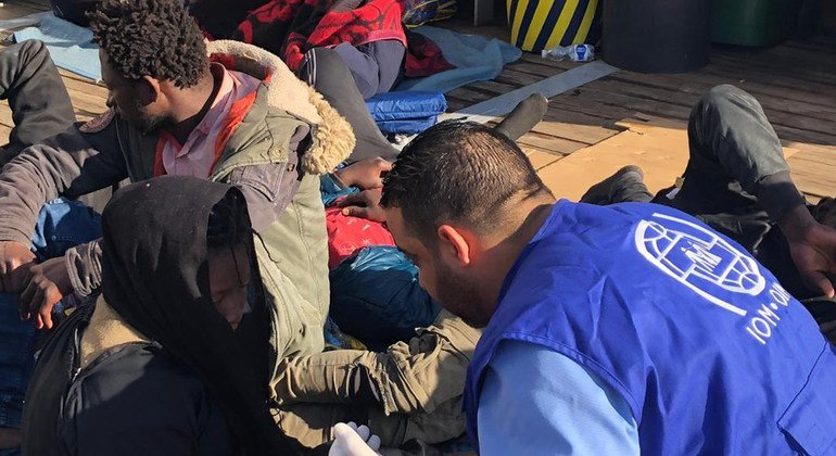 Migrants who have been returned to shore in Libya after attempting to cross the sea to Europe are supported by aid workers from the IOM.
