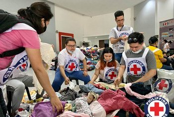 Students volunteer at a Red Cross logistics centre to pack relief goods for victims of the Taal volcano in the Philippines.