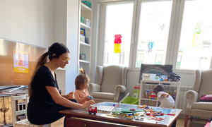 On the afternoon of Friday, 3 April 2020 in Madrid, Spain, Ruben, 4, and his little sister play while their mother, Daniela, gets in a little work.