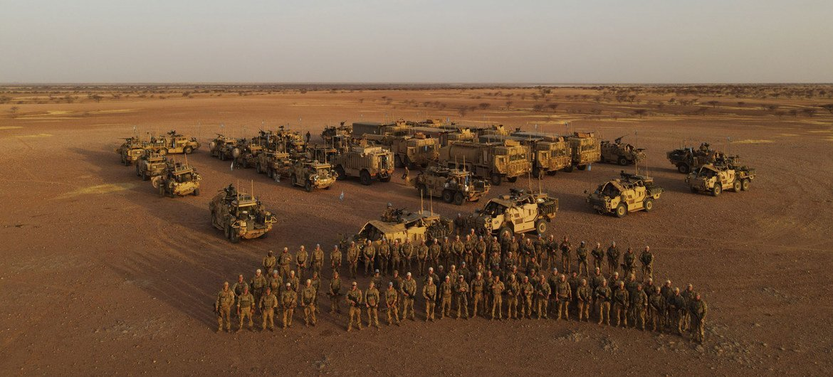 Peacekeepers from the UK contingent of MINUSMA, gather for a photo opportunity while on patrol in the Gao region of Mali.