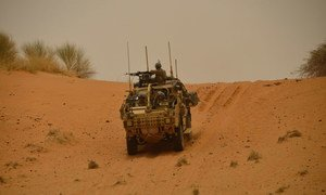 British Army driver and UN peacekeeper, Trooper Jack Drake pilots a Jackal 2 vehicle on patrol in the Gao region of Mali.