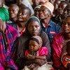 Wakimbizi wa Burundi waliorejea wakiwa wamekusanyika kwenye kijiji cha Higiro Kaskazini mwa Burundi