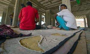 Migrants sleep in an abandoned, half-constructed building in Aden city, Yemen.