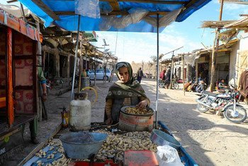 A young market vendor sells peanuts in Urozgan, a central province of Afghanistan.