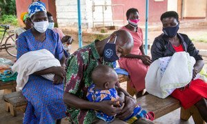 HIV-positive parents attend a support session at a clinic in Kamuli District, Uganda.