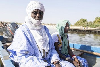 Youssouf Mbodou Mbami (l) the traditional leader of the Canton of Bol in Chad visits communities that he represents in Lake Chad