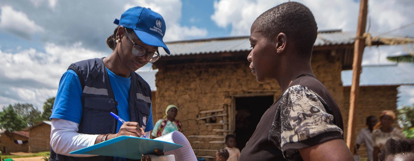 Marie-Roseline Darnycka Bélizaire, an epidemiologist with the World Health Organisation, speaks to a woman as part of the contact tracing effort during an Ebola outbreak in eastern Democratic Republic of the Congo.