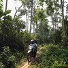 Marie-Roseline Darnycka Bélizaire, an epidemiologist with the World Health Organisation, rides through the forest near Itipo on the way to a follow-up visit with a contact.