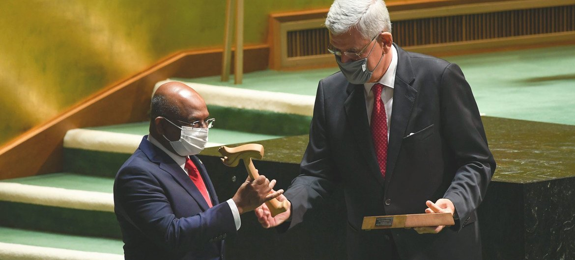Volkan Bozkir (right), President of the 75th session of the UN General Assembly, hands the gavel over to Abdulla Shahid, President of the 76th session of the United Nations General Assembly.