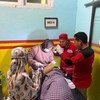 A person who was caught up in the 6.2 magnitude earthquake which struck West Sulawesi Province in Indonesia receives medical treatment.