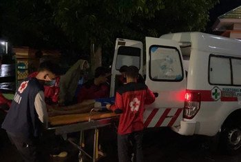 A victim of the earthquake that struck West Sulawesi Province in Indonesia on 15 January is moved into an ambulance.