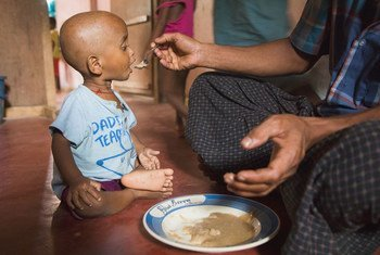 A child receiving food in Ukhiya, Cox's Bazar, Bangladesh. COVID-19 risks undermining efforts to reduce hunger.