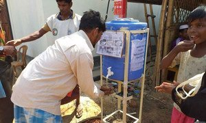 Rohingya refugees use a handwashing station, installed to help combat the spread of COVID-19 at a settlement in Cox's Bazar, Bangladesh.