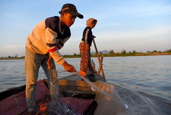 A young boy pulls a fishing net from the river at Kandal village in Kampong Chhnang, Cambodia.