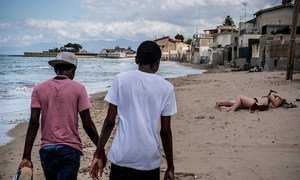 Two teenage brothers from Gambia who travelled across the Mediterranean Sea without their parents walk along a beach in Italy in 2016.