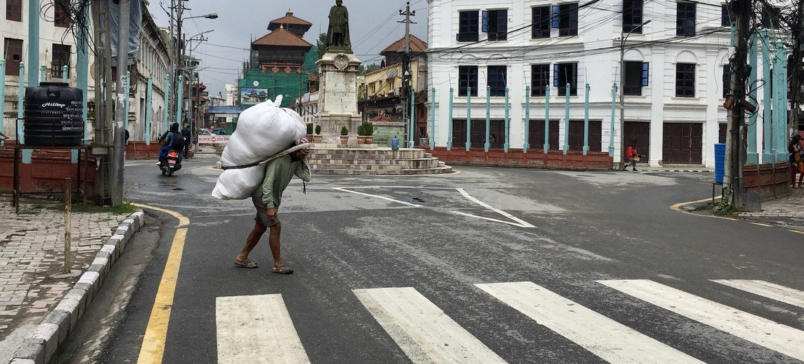 Developing countries, in particular, have been hit hard by the impacts of the coronavirus pandemic. Pictured, here a daily wage earner during the COVID-19 lockdown in Kathmandu, Nepal.
