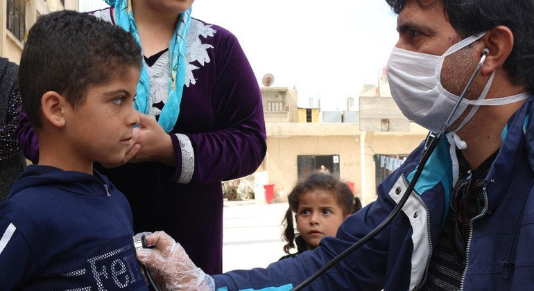 A young boy in Syria gets a health during the COVID-19 pandemic.