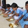 Children in India eating micronutrient enriched food as part of a WFP programme (file)