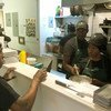 Trainee chef Roberta Mbiua (2nd right) receives his instructions from culinary director Alexander Harris at Emma's Torch Restaurant, Brooklyn.