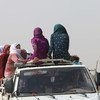 Syria, Al-Hasakah Governorate, 11 October 2019, women displaced by renewed fighting, travel sitting on top of a pick up truck