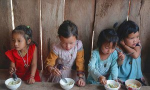Rice porridge is served to children at an EU supported health outreach centre in Phongsaly Province, Lao PDR.
