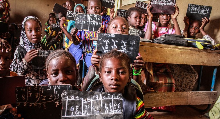 Children at a community school in Korioume, Tombouctou, Mali, sit on the ground as there are not enough benches to go around.