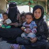 A family sits in the tent they live in at the Al Dhale'e Internally Displaced Persons (IDPs) Camp in Yemen.