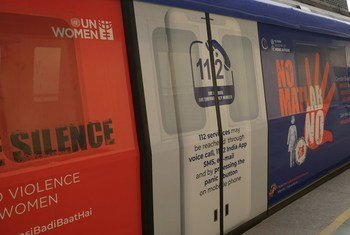 Marking the 'Orange the World' campaign in support of ending violence against women at Sultanpur Metro Station in New Delhi, India.