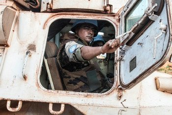 A Moroccan peacekeeper serving with MINUSCA sits in a UN armored vehicle on patrol in Bangassou, Central African Republic.