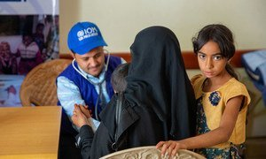 A young child is attended to by an IOM worker in Yemem. IOM are providing lifesaving health care to conflict affected communities, displaced people and migrants in Yemen, while strengthening public health facilities.