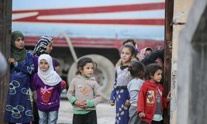 Children stand in the courtyard of a school-turned shelter in Ar-Raqqa, in Syria.