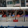 People ride a bus in Yangon, the largest city in Myanmar.