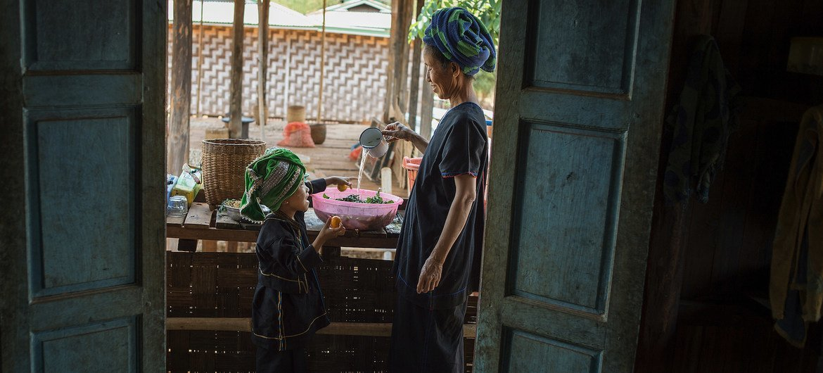 According to WFP, food prices have risen sharply since the start of the political crisis in Myanmar. Pictured here, a grandmother washes vegetables to prepare a meal at her home in the country's Shan state. (file photo)