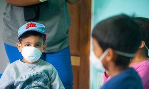 Children wear masks at a pre-school in Johannesburg, South Africa, during the COVID-19 outbreak.