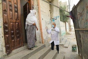 Health staff from the Shaboura Health Centre in Rafah, Gaza, run by UN relief agency UNRWA, deliver medications directly to elderly Palestine refugees in the wake of COVID-19, so reduce their chances of exposure.